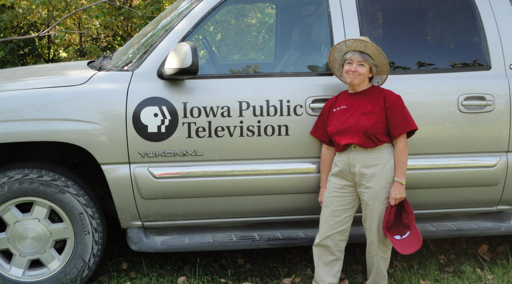 Kathy Dice stands by a Iowa Public Television Truck during taping of Iowa Ingredient.